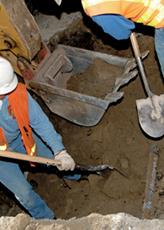 Excavators hand digging